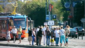 The arrival of the tram at a station in Moscow city stock footage