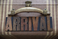 Arrival word on old luggage Royalty Free Stock Photos