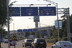 Arrivals and departures road sign in YVR airport Stock Photography