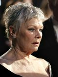 Arrivals At The Orange British Academy Film Awards. Actress Dame Judi Dench arrives at The Orange British Academy Film Awards at the Royal Opera House on Royalty Free Stock Photos