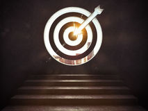 Arrive at a goal of success.the stairs up to a target. 3D Rendering. Stairs up to a target with the arrow etched in the wall. Arrive at a goal of success concept Stock Photos
