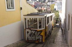 The arrive of Lavra Funicular in Lisbon. LISBON, PORTUGAL - OCTOBER 25 2014: The arrive of Lavra Funicular in Lisbon, in its narrow street Stock Images