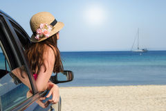 Arriving on the beach. Young woman in the car arrived on the beach Royalty Free Stock Photo