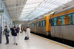 Arriving departing people train station Santa Apolonia, Lisbon Stock Photos