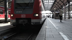 Arriving German S-Bahn. Wiesbaden, Germany - March 13, 2014: Many passengers are leaving a suburb train of german railroad company DB at the railroad station of stock video