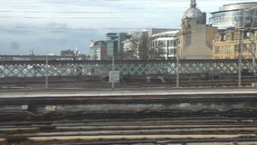 Arriving at Glasgow city Central Station. Train passenger window view of railway and other transport bridges in the Scottish city of Glasgow when crossing river stock video