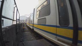 Arriving light railway transit at station. Manila, Philippines - October 26, 2015: Arriving Light Rail Transit Train in passenger station, a build-operate stock video footage