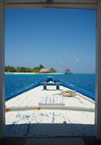 Arriving on a paradise island in the Maldives dhoni landing  Mar-16-09. Arriving by traditional Maldives dhoni boat on island paradise Royalty Free Stock Photography