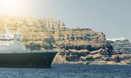 Arriving passenger ship sailing before chalk cliffs coast Royalty Free Stock Photos