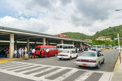 Arriving passengers and pickup vehicles at Airport. Montego Bay, Jamaica - June 06 2015: Arriving passengers and pickup vehicles at Arrivals in the Sangster royalty free stock photos