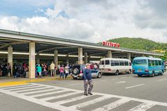 Arriving passengers and pickup vehicles at Airport. Montego Bay, Jamaica - June 06 2015: Arriving passengers and pickup vehicles at Arrivals in the Sangster stock photography