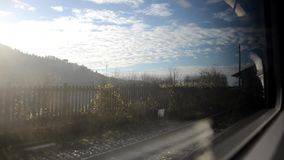Arriving at the station from the train. Window stock video footage