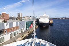 Arriving to Halifax. A cruise ship docked in front of another cruise liner in the city of Halifax (Nova Scotia, Canada Royalty Free Stock Image