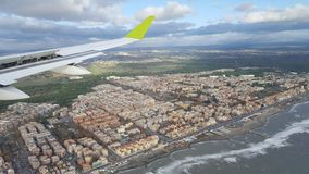 Arriving to Rome, Italy by plane. Plane starts to land in Rome, Italy. Rome city and coast of Mediterranean sea on the background Royalty Free Stock Photos