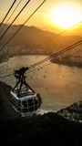 Arriving on the top. The cable car of the Sugarloaf mountain, Rio de Janeiro,  arriving on its top during the beatiful sunset across the Botafogo beach Royalty Free Stock Photography