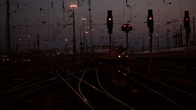 Arriving train. Railyard and arriving train at dusk stock video footage
