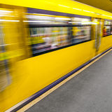 Arriving underground train at a platform Stock Photos