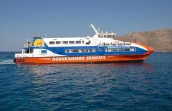 Arrivo del traghetto, Tilos Immagine Stock