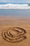 Arroba on the sand 2. An arroba symbol drawing on the sand Stock Photos