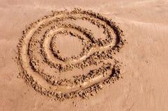 Arroba on the sand. An arroba symbol drawing on the sand Stock Photo