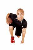 Arrodillamiento del futbolista. Foto de archivo libre de regalías