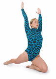 Arrodillamiento del gimnasta Fotos de archivo