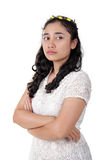 Arrogant antagonistic lady. Portrait of antagonist Asian lady with arrogant face, standing with her arms crossed, isolated on white background Royalty Free Stock Photo