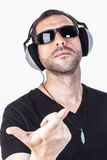 Arrogant Attitude. A man with black sunglases and headphones, doing a a gang symbol with your hands. Vertical format Stock Photography