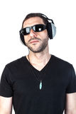 Arrogant Attitude. A seriously man with silver headphones and black sunglasses, and arrogant attitude Stock Images