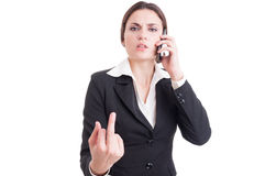 Arrogant and bossy business woman showing obscene insulting midd Royalty Free Stock Image