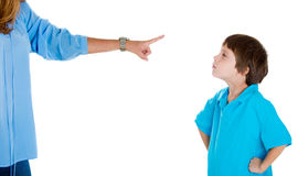 Arrogant kid with hands on hips disobeying his mother's orders. Closeup portrait of parent pointing at child in blue shirt scolding go to room grounded for Royalty Free Stock Photos