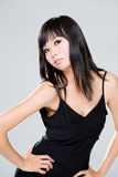 Arrogant look of asian woman. Arrogant looking asian beauty with long black hair royalty free stock photo
