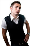 Arrogant macho man. Young man with arrogant expression isolated on white royalty free stock image