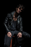 Arrogant man in leather jacket looking down you Royalty Free Stock Image