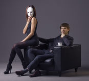 Arrogant man and masked woman Royalty Free Stock Photos