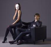 Arrogant man and masked woman royalty free stock photos