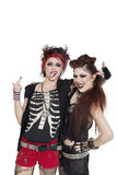 Arrogant punk females showing middle finger over white background Stock Photo