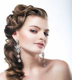 Delight. Elegant Posh Woman Bride with Diamond Earrings. Platinum Jewelry Royalty Free Stock Image