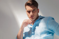 Arrogant young casual man looking at the camera royalty free stock images