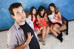 Arrogant Young Man With Girlfriends Royalty Free Stock Photos