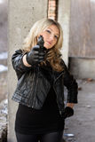 Arrogant young woman with a gun Stock Photo
