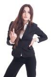 Arrogante Geschäftsfrau, die obszönen Beleidigungsmittelfinger zeigt Stockbild
