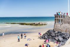 ARROMANCHE LES BAINS, FRANCE - JUNE 2014: Tourists visit beautiful coast. Normandy is a major attraction in France.  stock images