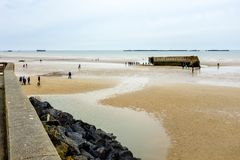 Arromanches beach. With the remains of the artificial harbor set up during the World War II Royalty Free Stock Image