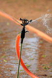 Arroseuse de l'eau images libres de droits