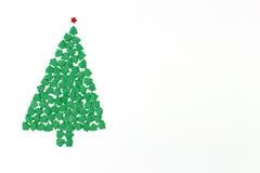 Arrosez l'arbre de Noël Photographie stock libre de droits