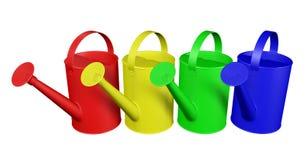 Arrosoirs - colorés Photos stock