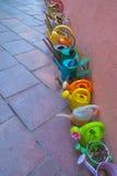 Arrosoirs colorés Photographie stock libre de droits
