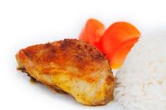 Arrostito chiken le coscie, il riso ed il pomodoro Fotografie Stock Libere da Diritti