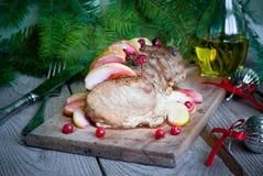 Arrosto di maiale con le mele ed i mirtilli rossi Fotografia Stock